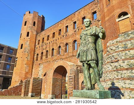 Gaius Julius Caesar Statue In Front Of Porta Palatina Gate. Piazza Cesare Augusto Square. Turin, Pie