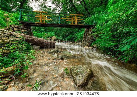 Wooden Bridge Over Waterfall In Himalayas - Sainj, Kullu, Himachal, India