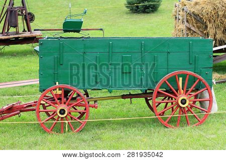 A Horse Drawn Grain Wagon With Wooden Wheels Used In The 1920-1930 Farming Era.