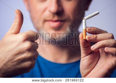 Stop Smoking Cigarettes Concept. Broken Cigarette In Hands. Quit Bad Habit, Health Care And People C