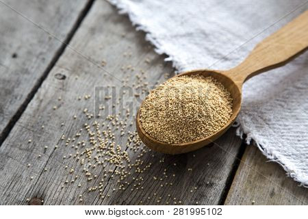 Amaranth Seeds In A Wooden Spoon On Table, Selective Focus. Raw Organic Amaranth Grain