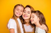 Close-up portrait of three nice cute winsome lovable lovely sweet tender attractive cheerful caucasian people cuddling mum mommy closed eyes isolated over bright vivid shine yellow background poster