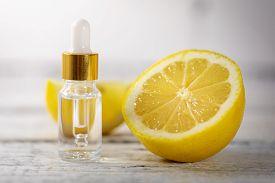 Lemon Essential Oil Bottle With Fresh Lemon