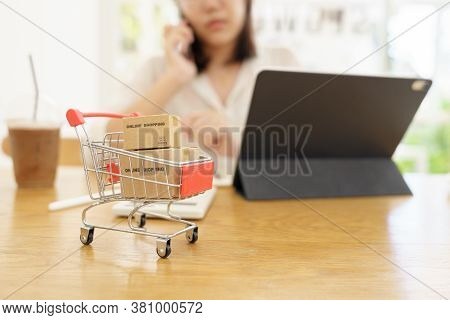 Online Shopping With A Shopping Cart And Shopping Bags Delivery Service Using As Background Shopping