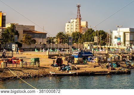 Port Sudan, Sudan, 07/04/19. Busy Coast In A Harbor In Port Sudan, With Sudanese People Trading Good