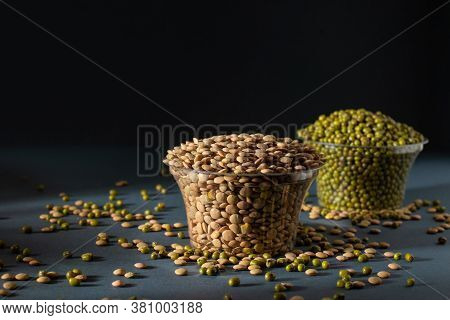 Masoor Dal In Glass Pot With Blurry Mung Bean Image, Black Background, Photography