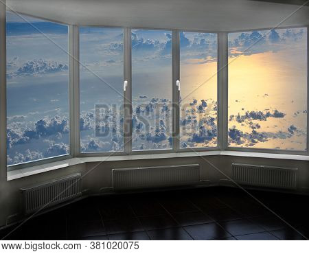 Cozy Room Overlooking Clouds Above Sea. Landscape With Clouds Above Ocean. Window With Beautiful Cel