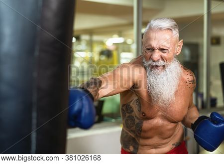 Senior Man Boxer Training Hard - Elderly Male Boxing In Sport Gym Center Club - Health Fitness And S