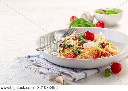 Spaghetti With Pesto Sauce, Fresh Basil And Cherry-tomatoes.