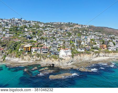 Aerial View Of Laguna Beach Coastline Town With Wealthy Villas On The Cliff, Southern California Coa