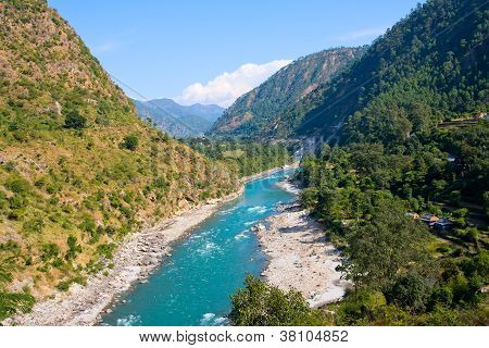 Ganges River In Himalayas Mountains