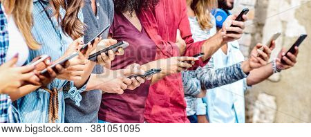 Cropped View On Millenial Hands Using Mobile Smart Phones - People Addicted By Smartphones - Technol