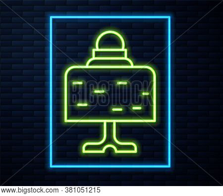 Glowing Neon Line Magic Ball On Table Icon Isolated On Brick Wall Background. Crystal Ball. Vector