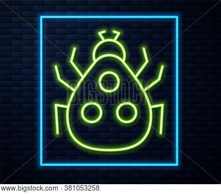 Glowing Neon Line Ladybug Icon Isolated On Brick Wall Background. Vector