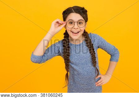 Show Your Smile And Be Positive. Happy Child Smile In Glasses Yellow Background. Small Kid With Heal