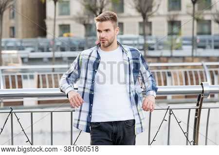 Affordable Fashion For Every Day. Sexy Man Lean On Railing Urban Outdoors. Casual Wear And Clothing.