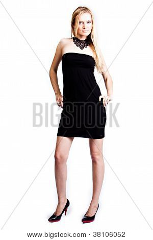 A woman in a black cocktail dress