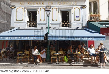 Paris, France - August 02 , 2020 : People Sitting In A Traditional French Cafe Au Rocher De Cancale