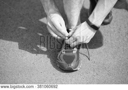 Tying Shoelaces Properly. Tying And Lacing Running Shoes. Male Hands Lace Sport Shoe. Athletic Footw