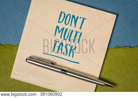 do not multitask -  efficiency advice or reminder - handwriting on a napkin, business and personal development concept