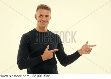 Your Logo. Happy Man Pointing Fingers Isolated On White. Handsome Guy Pointing At Something. Pointin
