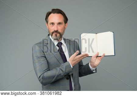 Accountant Presenting Accounting Records. Copy Space In Notebook. Show The To-do List In Diary. Univ