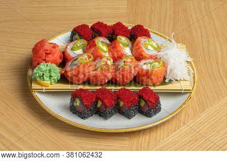 Sushi Set Of Different Rolls With Tuna, Salmon, Shrimps, Tobiko Flying Fish Roe, Ginger, Daikon Radi
