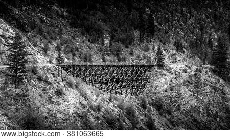 Black And White Photo Of One Of The 18 Wooden Trestle Bridges Of The Abandoned Kettle Valley Railway
