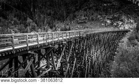 Black And White Photo Of A Wooden Trestle Bridges Of The Abandoned Kettle Valley Railway In Myra Can