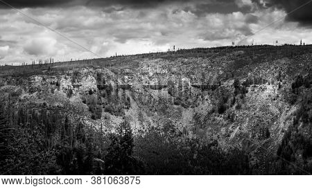 Black And White Photo Of A Series Of Wooden Trestle Bridges Of The Abandoned Kettle Valley Railway V