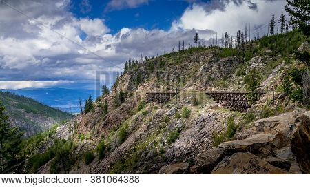Series Of Wooden Trestle Bridges Of The Abandoned Kettle Valley Railway Viewed From Across Myra Cany