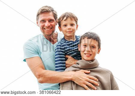 Happy Portrait Of Father With Children (two Boys) On White Isolated Background. Concept Of A Friendl