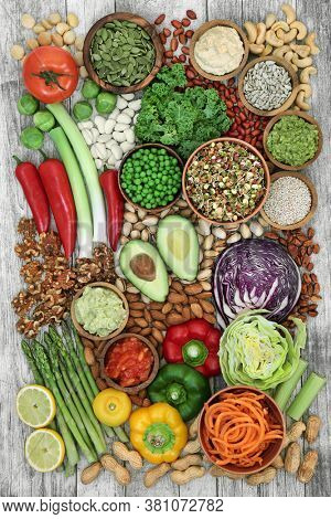 Low glycemic health food for diabetics with foods below 55 on the GI index. High in vitamins, minerals, anthocyanins, protein, antioxidants & smart carbs. On rustic wood. Top view.