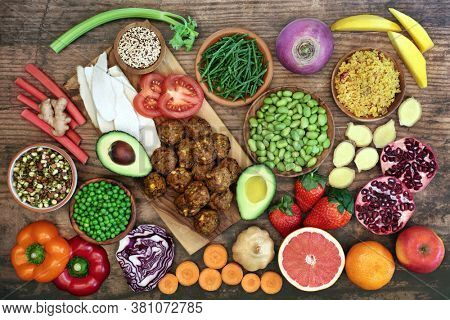 Healthy super food for fitness with health foods high in antioxidants, anthocyanins, vitamins, minerals, protein,  smart carbs, omega 3 and fibre. Flat lay on rustic wood background.