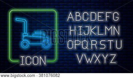 Glowing Neon Lawn Mower Icon Isolated On Brick Wall Background. Lawn Mower Cutting Grass. Neon Light