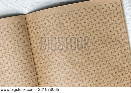Squared Paper Of Notebook Background, Blank Pages Of Retro Sketchbook. Top View Of Vintage Grid Shee