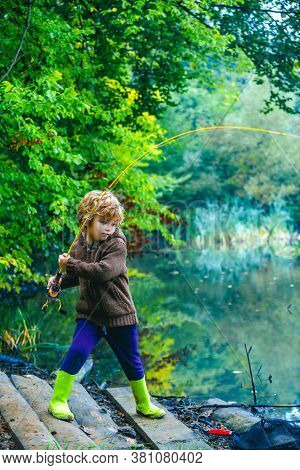 Child Pulling Rod While Fishing On Weekend