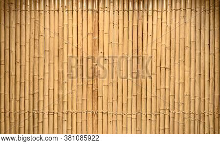 Close Up Background And Texture Of Decorative Yellow Bamboo Wood On Finishing Wall Surface. Bamboo S