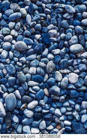 Beautiful Background Of Smooth Round Pebbles Sea, Top View, Adjusted Colour To Dark Blue Tone. Verti
