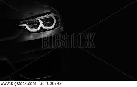 Detail On One Of The Led Headlights Modern Car On Black Background,free Space On Right Side For Text