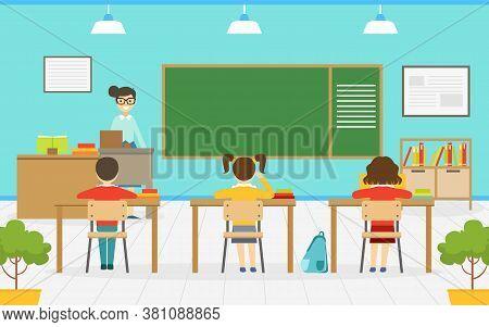 Elementary School Students Studying In Classroom, Teacher Explaining Lesson, Classroom Interior, Edu