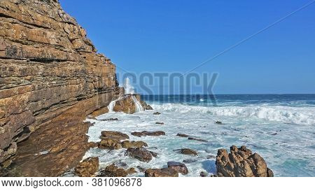Waves Are Beating Against The Inaccessible Rocks Of The Cape Of Good Hope. White Foam On The Turquoi