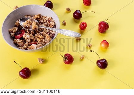 Muesli With Fresh Fruits And Yogurt.porridge With Fresh Strawberry And Cherries.natural Yogurt With