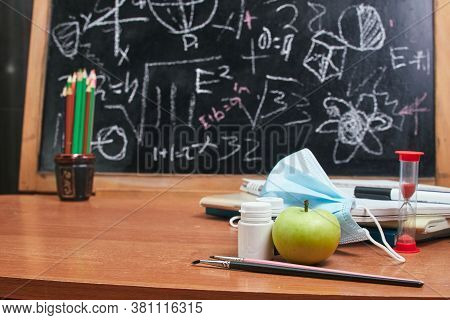 School Supplies On The Table And A Medical Mask In The Background School Board, School, University,