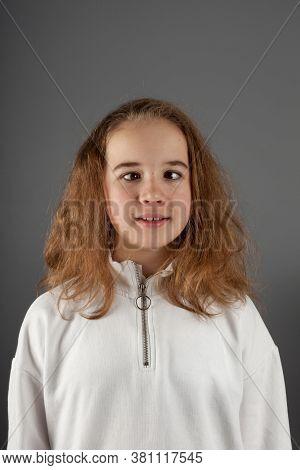 Cute Teenage Blond Girl In White Hoody With Slanting Eyes