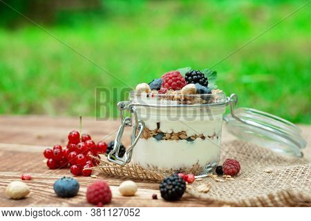Muesli Granola With Yogurt And Fresh Red Currant Berries Raspberries Blueberries And Blackberries, N