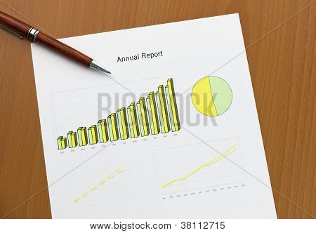 Annual Report Chart Print Paper, Pen On Desk. Monthly Stats.
