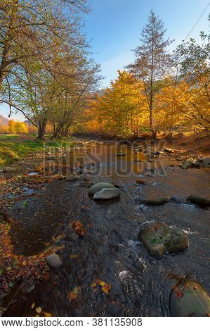 Mountain River Among The Forest In Autumn. Sunny Morning Landscape. Rocks In The Water Stream. Cloud
