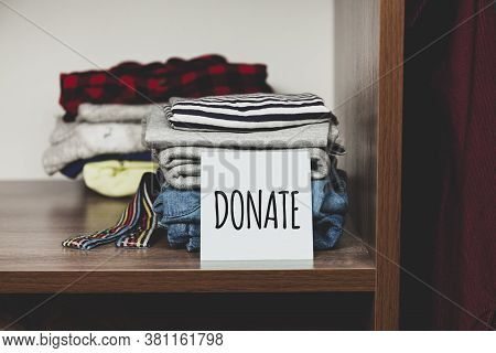 Stack Of Old Clothes To Discard (declutter) Or Donate. Recycling Fabric Cotton.