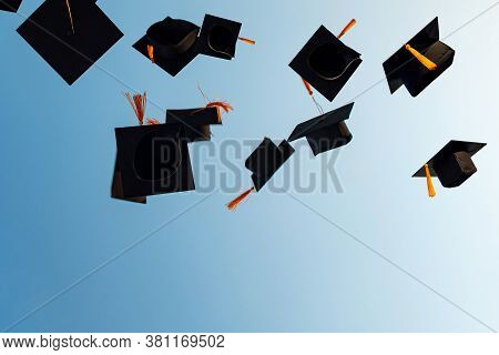 Graduates Throw Black Hats In The Sky.